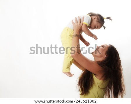 very young mother with one year old baby - stock photo