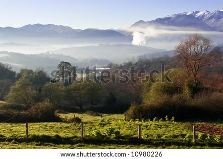 Vespertine foggy landscape in Asturias, north of Spain - stock photo