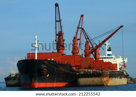 Vessel cargo with crane are working in the gulf of Thailand.