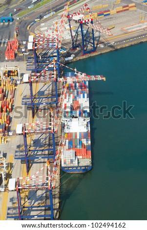 vessel offloading containers at durban harbour, south africa - stock photo