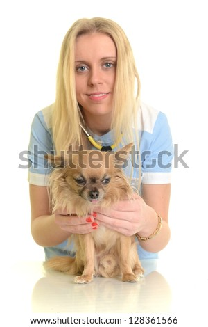 Vet using technology with a little dog - isolated over a white background - stock photo