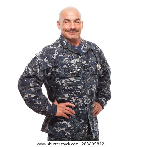 Veteran Soldier   Corpsman, Navy sailor, chief or doctor grinning with hands on hips. - stock photo
