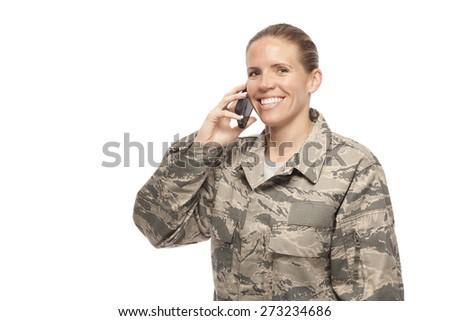 Veteran Soldier | Portrait of happy female airman talking on mobile phone - stock photo