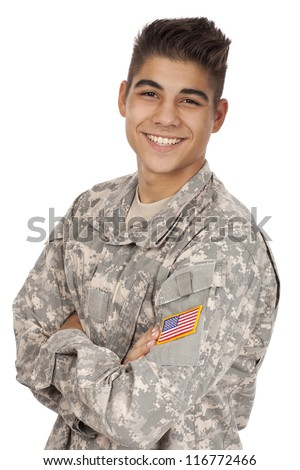 Veteran soldier smiling with his arms crossed. - stock photo