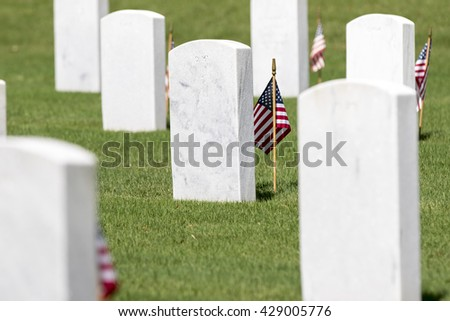 veterans cemetery memorial celebration with American Flag - stock photo