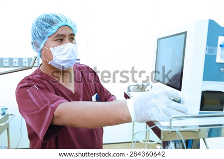 veterinarian assistant in operation room - stock photo