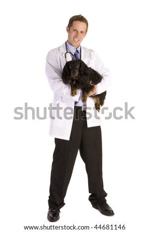 Veterinarian on white holding a black dog - stock photo