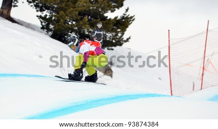VEYSONNAZ, SWITZERLAND - JANUARY 19: Ladies Finalist Zoe Gillings (GB) competes in the FIS World Championship Snowboard Cross finals on January 19, 2012 in Veysonnaz Switzerland