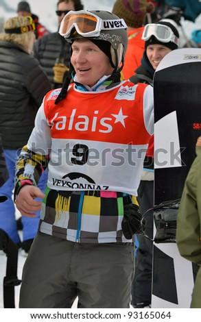 VEYSONNAZ, SWITZERLAND - JANUARY 19: World Champion Andrey Boldikov (RUS) having just won the FIS World Championship Snowboard Cross finals : January 19, 2012 in Veysonnaz Switzerland - stock photo