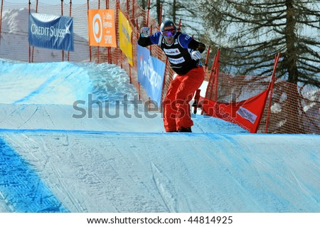 VEYSONNAZ, SWITZERLAND - JANUARY 15: World championship Snowboard cross  finals. Silver medalist David Speiser. January 15 in Veysonnaz, Switzerland.