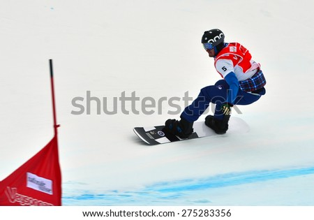 VEYSONNAZ, SWITZERLAND - MARCH 14:  Nikolai OLYUNIN (RUS) competing in the finals of the Snowboard Cross World Cup: March 14, 2015 in Veysonnaz, Switzerland - stock photo