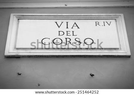 Via del Corso - one of the most famous streets in Rome, Italy. Black and white retro style - monochrome color tone. - stock photo