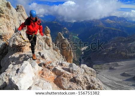 Via ferrata climbing in sunny day, Dolomite Alps, Italy - stock photo