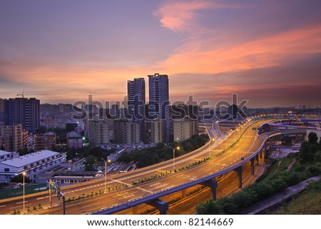 Viaduct and the city night driving at night - stock photo