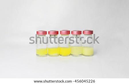Vials isolate on the grey background : medication,vaccine, drugs, serum, CSF, antibiotic,  laboratory. - stock photo