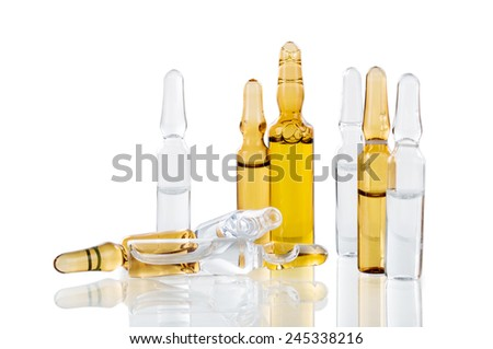 vials of medicine on a white background - stock photo
