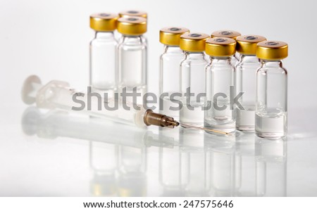 Vials of the vaccine and syringe - stock photo