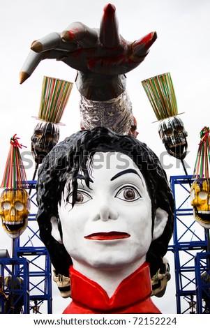 VIAREGGIO, ITALY - FEBRUARY 21: Carnival floats parade on the promenade of Viareggio, during the famous Carnival of Viareggio on February 21, 2010 in Viareggio, Italy - stock photo
