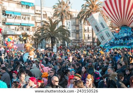 VIAREGGIO, ITALY - FEBRUARY 22, 2014: Carnival floats parade on the promenade of Viareggio, filled with people during the famous Carnival of Viareggio. - stock photo