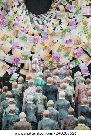 VIAREGGIO, ITALY - FEBRUARY 22, 2014: Carnival floats parade with people looking for money on the promenade of Viareggio during carnival. - stock photo