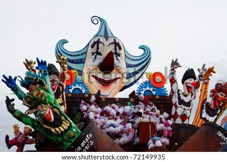 VIAREGGIO, ITALY -  FEBRUARY 21: Clown statues on a Happiness themed float during Carnival of Viareggio, one of the most famous in the world on February 21, 2010 in Viareggio, Italy - stock photo