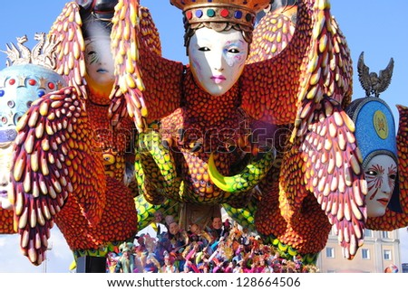 VIAREGGIO, ITALY - 10 FEBRUARY 2013 : Festival, the parade of carnival floats with dancing people on streets of Viareggio, February 10, 2013 in Viareggio,Italy - stock photo