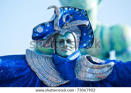 VIAREGGIO, ITALY - MARCH 8:  man in carnival mask, during the famous Carnival of Viareggio on march 8, 2011 in Viareggio, Italy - stock photo