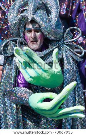 VIAREGGIO, ITALY - MARCH 6:  old man in carnival mask, during the famous Carnival of Viareggio on march 6, 2011 in Viareggio, Italy - stock photo