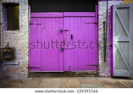 Vibrant barn door style doors on exterior  - stock photo