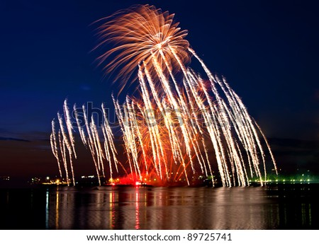 Vibrant beautiful firework on the holiday day - stock photo