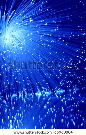 Vibrant blue fibre optics. - stock photo