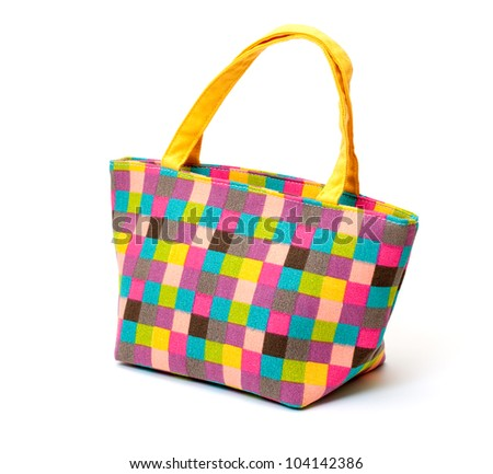 Vibrant Cloth Ladies Handbag on white background - stock photo