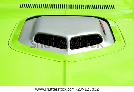 Vibrant colored customized car hood - stock photo