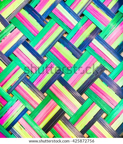 Vibrant colorful wicker fibres a sa background