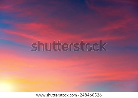 Vibrant colors of the sky with clouds during sunset. - stock photo