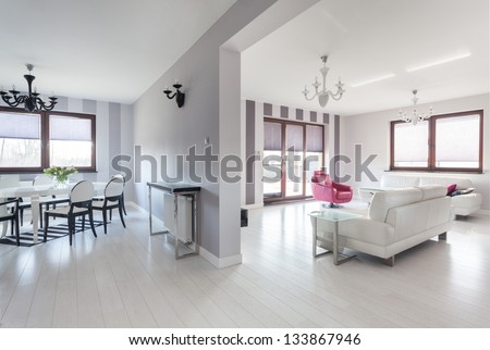 Vibrant cottage - living room and a dining room - stock photo