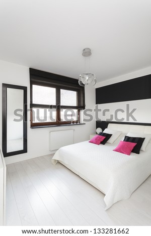 Vibrant cottage - Modern bedroom with white and black colors - stock photo