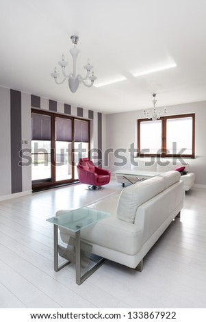 Vibrant cottage - white comfortable sofa in living room - stock photo