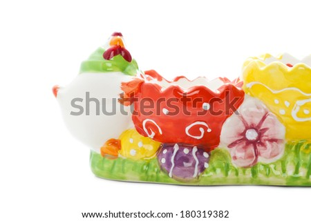 Vibrant empty easter egg holder isolated on white - stock photo