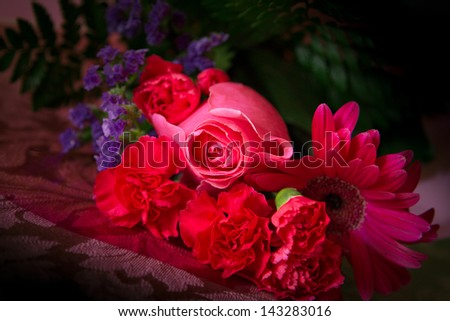 Vibrant floral bouquet against dark background - stock photo