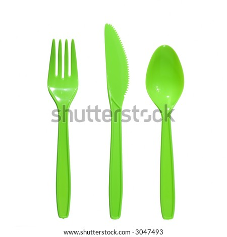 vibrant green plastic fork, knife and spoon isolated on white - stock photo