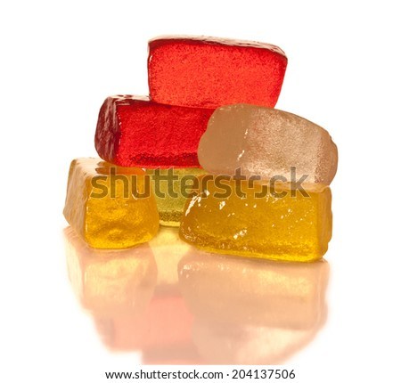 Vibrant gummy candies in a heap on the white background - stock photo