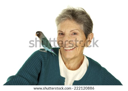 Vibrant Happy Senior Woman on a White Background with her pet lovebird on her shoulder