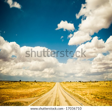 vibrant image of highway and blue sky - stock photo