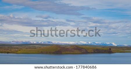vibrant landscape with famous icelandic  lake region myvatn - stock photo