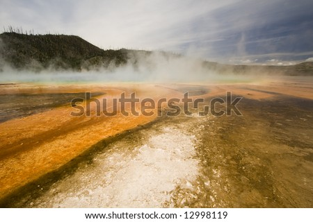 Vibrant orange colors of Grand Prismatic Spring in Yellowstone National Park. - stock photo