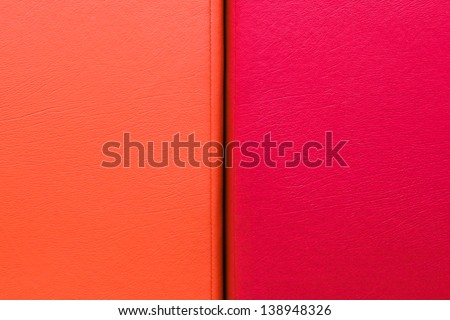 Vibrant red and orange leather as a background - stock photo