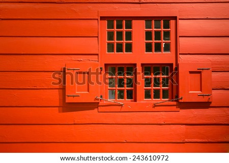 vibrant red exterior wall and window - stock photo