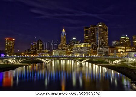Vibrant skyline of Columbus, Ohio with the Main Street Bridge - stock photo