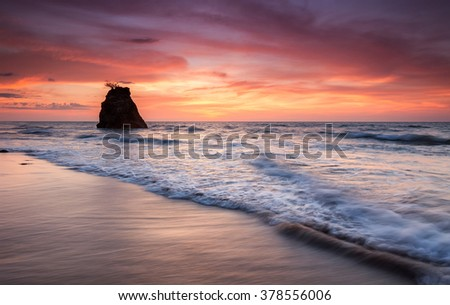 Vibrant Sunset Scene at Coastline with Copy Space Area. Taken with Slow Shutter Speed image might be soft focus, motion blur when view at full resolution